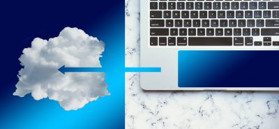 Large laptop pointing to cloud